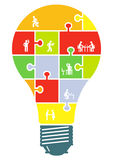 Cooperation and partnership. Concept illustration with a light bulb and business people inside Royalty Free Stock Photography