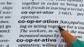 Cooperation, pencil pointing word in vocabulary process of teamwork togetherness stock video