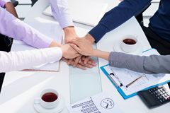 Cooperation and solidarity. Business people stacking hands: cooperation and solidarity concept stock photo