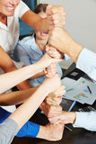 Cooperation and teamwork with many stacked fists stock images