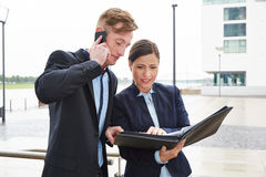 Cooperation of two business people Stock Photo