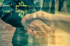 Cooperation between the two parties business. Cooperation between the two parties in the investment business, Concept business Stock Image