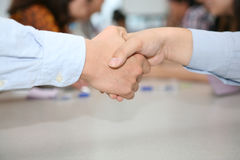 Cooperative handshake Stock Images