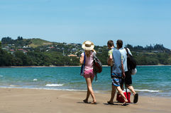 Coopers Beach in Northland New Zealand. COOPERS BEACH, NZ - DEC 21:Visitors on coopers beach on Dec 21 2013.It's a famous holiday travel destination in Northland Stock Photo