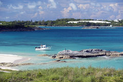 Coopers Island Nature Reserve, Bermuda. A vessel from the Bermuda Institute of Ocean Sciences anchors in Long Bay off Coopers Island Nature Reserve. The outing Royalty Free Stock Photos