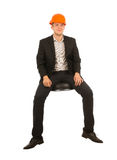 Coordenador masculino novo de assento de sorriso Looking na came foto de stock