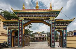 Nunnery gate at Namdroling Buddhist Monastery, Coorg India. Royalty Free Stock Photos