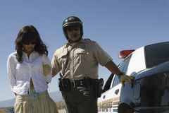 Cop Arresting Female Driver Royalty Free Stock Photography