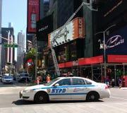 Cop Auto, Times Square, NYC, NY, de V.S. stock foto's