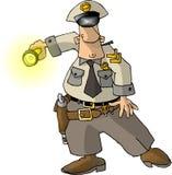Cop avec une lampe-torche Photographie stock