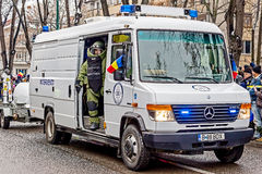 Cop from bomb squad simulating a mission. TIMISOARA, ROMANIA - DECEMBER 1, 2016: Military parade at Romanian National Day. Cop from bomb squad simulating a Stock Image