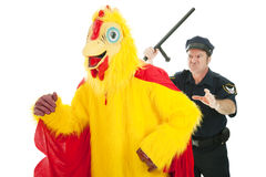 Cop Chasing Chicken Man Royalty Free Stock Images