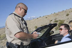 Cop Checking Man's License Royalty Free Stock Image