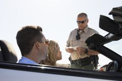 Cop Checking Woman's License Royalty Free Stock Image
