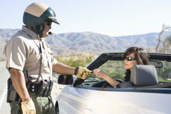 Cop Checking Woman's License Stock Images