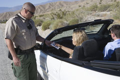 Cop Checking Woman's License Royalty Free Stock Images