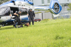 Cop dog coming out Police Helicopter Royalty Free Stock Image