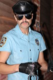 Cop with mustache, sunglasses and hat Royalty Free Stock Photography