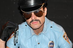 Cop with mustache, sunglasses and hat Royalty Free Stock Photo