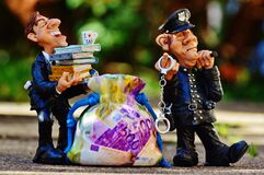 Cop and official with sack of money Stock Photos