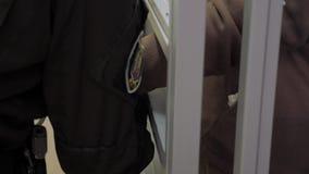 Cop putting handcuffs on a suspect. Man hands in handcuffs. Man hands in handcuffs. Cop putting handcuffs on a suspect stock footage