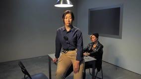 Asian policewoman in interrogation room