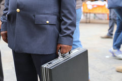 cop with a suitcase with many documents Royalty Free Stock Photos