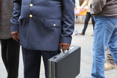 Cop with a suitcase with many secret documents Stock Image