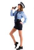 Cop van de dame het stellen met kanon op witte achtergrond Royalty-vrije Stock Foto