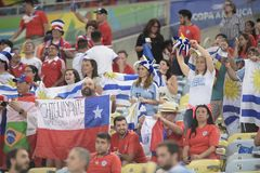 Copa america 2019. RIO DE JANEIRO, BRAZIL - June 24, 2019: Soccer fans celebrating at the 2019 Copa America Group C game between Chile and Uruguay at Maracana royalty free stock photo