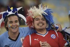 Copa america 2019. RIO DE JANEIRO, BRAZIL - June 24, 2019: Soccer fans celebrating at the 2019 Copa America Group C game between Chile and Uruguay at Maracana stock images