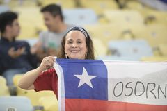 Copa america 2019. RIO DE JANEIRO, BRAZIL - June 24, 2019: Soccer fans celebrating at the 2019 Copa America Group C game between Chile and Uruguay at Maracana royalty free stock photography