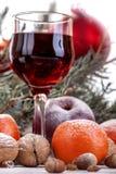Copa de vino con las frutas y las nueces Imagenes de archivo