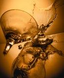 Copa de vino en fondo anaranjado Foto de archivo libre de regalías