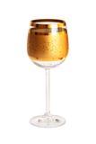 Copa de vino vacía con el dorado Imagen de archivo