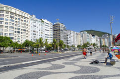 Copacabana beach buildings. People walking and having a great time Royalty Free Stock Photography