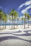 Copacabana Beach with palms and landmark mosaic in Rio de Janeiro Royalty Free Stock Photos