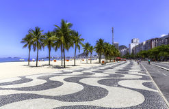Copacabana beach with palms and sidewalk Stock Image