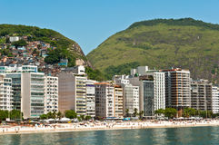 Copacabana Beach, Rio de Janeiro, Brazil. Luxury residential apartment and hotel buildings in the front of the Copacabana beach with mountains behind in Rio de Stock Images