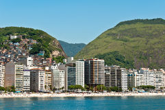 Copacabana Beach, Rio de Janeiro, Brazil. Luxury residential apartment and hotel buildings in the front of the Copacabana beach with mountains behind in Rio de Royalty Free Stock Images
