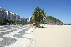 Copacabana Beach Skyline Boardwalk Rio de Janeiro Brazil. Copacabana Beach Rio de Janeiro Brazil skyline with iconic sidewalk tile pattern royalty free stock photo