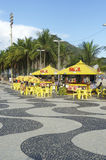 Copacabana Beach Skyline Boardwalk Rio de Janeiro Brazil. RIO DE JANEIRO, BRAZIL - MARCH 27, 2015: Traditional beachside kiosk with palm trees along the royalty free stock photography