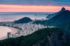Copacabana Beach by Sunset. View of Copacabana beach by sunset with a pink sky, Rio de Janeiro, Brazil royalty free stock photo