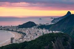 Copacabana Beach by Sunset. View of Copacabana beach by sunset with a pink sky, Rio de Janeiro, Brazil stock images