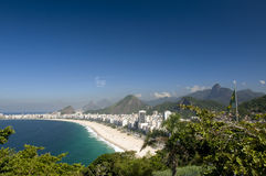 Copacabana and Brazilian Flag and Corcovado. The famous beach of Rio de Janeiro, in a view from the top of Duque de Caxias fortness, with the brazilain flag.  In Stock Photography