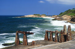 Copacabana Fort and Arpoador. Ruins of Copacabana Fort with Arpoador and Devil`s Beach at the back stock photos