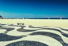 Copacabana with mosaic of sidewalk in Rio de Janeiro Stock Photos
