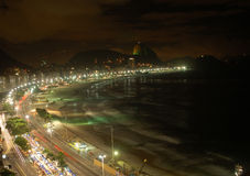 Copacabana by night. Copacabana beach by night, with sugar loaf mount at background royalty free stock photos
