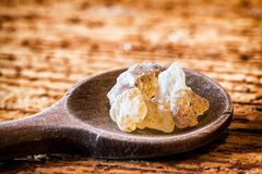 Copal. Incense on an old kitchen spoon - copal Royalty Free Stock Image