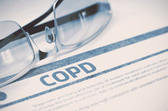 COPD - Printed Diagnosis. Medicine Concept. 3D Illustration. COPD - Chronic Obstructive Pulmonary Disease - Medicine Concept with Blurred Text and Spectacles on royalty free stock photo